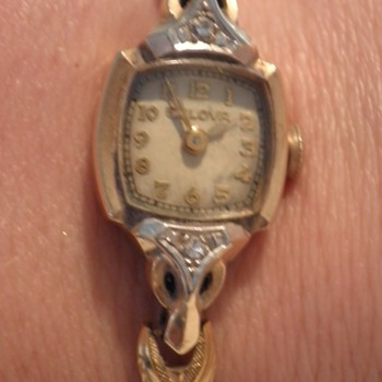 Is this gold filled or 14K and what is the time period.  - Wristwatches