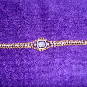 Beautiful  Bulova watch and custom made diamond band