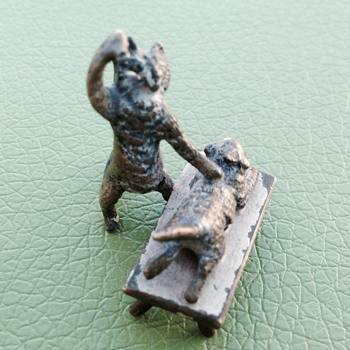 A tiny little odd brass cat figurine.  - Figurines