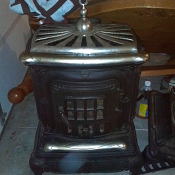 I have this parlor stove with nickle plating on it &let's i want to know it's value please! - Kitchen