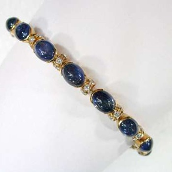 18K yellow gold diamond and sapphire cabochons bracelet. - Fine Jewelry