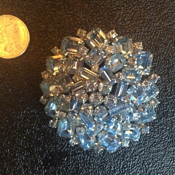 Help me identify the big, blue brooch from the 50s!