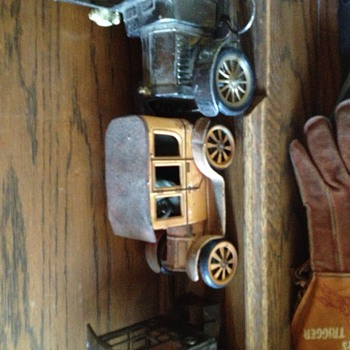 Old toy vehicles one with rear wheel lever actuated drive - Model Cars