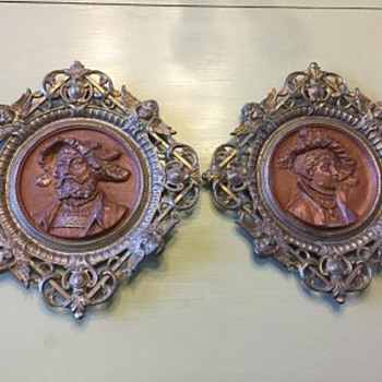 antique heavy metal relief portraits with attached heavy metal frames