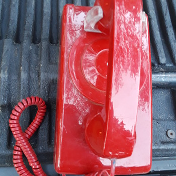 red 'in case of emergency' wall telephone - Telephones