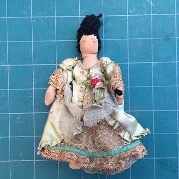 Found: Cloth doll with ball gown