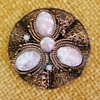 What's your opinion on this brooch/stones