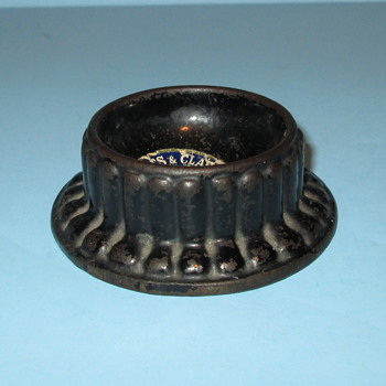 Tatum's Cast Iron What? Ink well holder? Caster? Pin holder?
