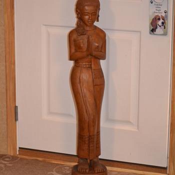 Teak wood welcoming woman