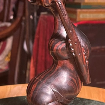 Carving of a Severely Handicapped Flute Player - Asian