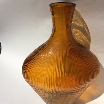 Who could possibly made this Golden Honey Amber Textured bottle or vase - Glassware