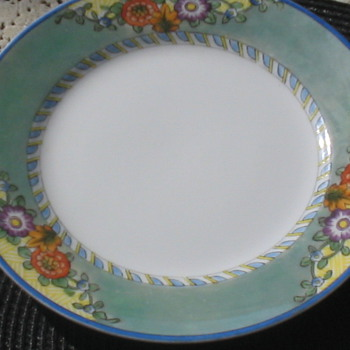 I had Bought this set Cheap any ideas 12 big plates  - China and Dinnerware
