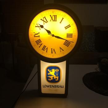1986 Lowenbrau lighted beer sign clock.