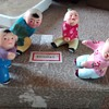 Chinese or Far east children ceramic characters boxed unhappy souls with expressive facial features