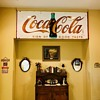 ...just covering up more wall space with the Coca Cola sign collection...