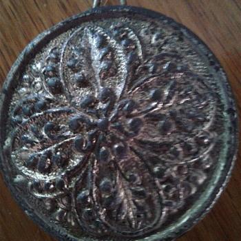 Unusual  lead or pewter  medallion  - Clocks
