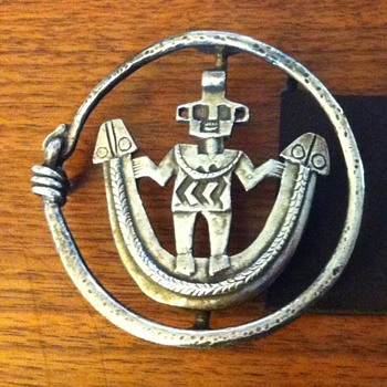 Old Native American Belt buckle with figure and snakes