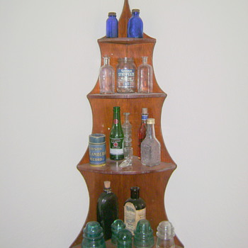 My small glass collection and Edison record on corner shelf. - Bottles