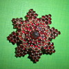 Gold-plated Victorian brooch star with  Bohemian garnet 19th century.