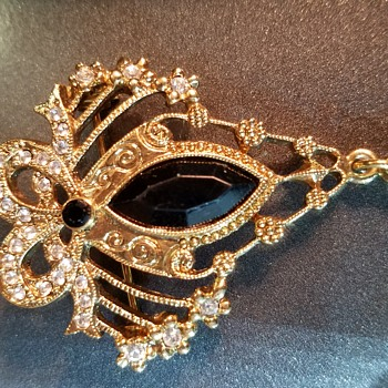 Gold tone and stone brooch