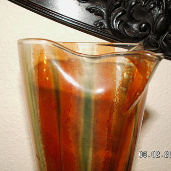 Delicate amber color glass with faded vertical red and blue stripes; it has a pour spout.  I would be most grateful for i.d. - Art Glass