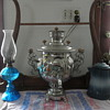 20th century samovar with vintage oil lamp and vintage enameled coffee pot