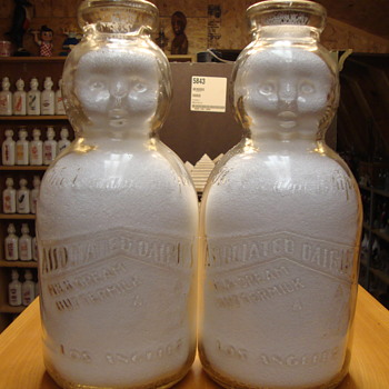Two Associated Dairy Embossed 1/2 Gallon Baby Tops.... - Bottles