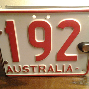 Repurposed Aussie license plate photo album.  - Signs