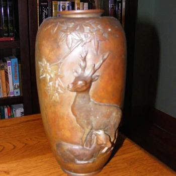 Copper urn with deer