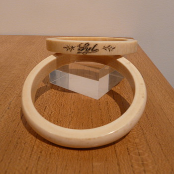 TWO IVORY BANGLES  - Costume Jewelry