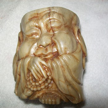 Old guy on a cup - Asian
