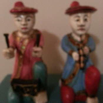 I believe these are carved wooden Mandarin musicians