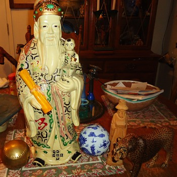 Garage sale mistakes from long ago!  From box under bed!  Chinese man, China ball, brass baseball, wood leopard and man from Ec