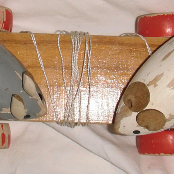 Mice move as you pull toy how old & from which co or hand made?