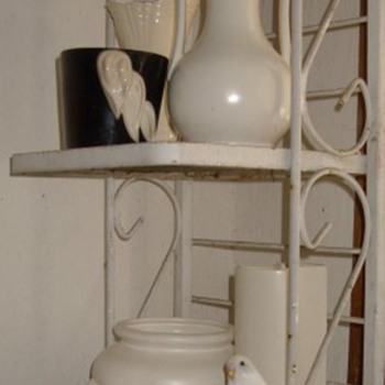 Cumi camoflage on my white pottery rack and some other bird stuff - Pottery