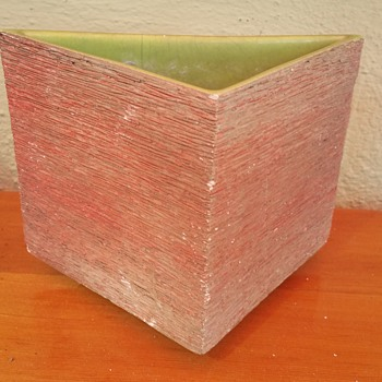 Interesting!! Hanging ceramic potting pot :)
