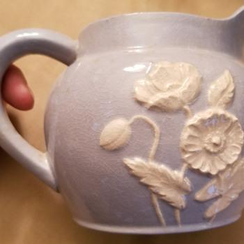 Maruhon blue vase with white raised Poppy design - Pottery