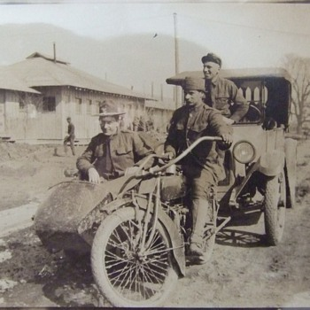 WW1 soldier on Indian motorcycle with sidecar