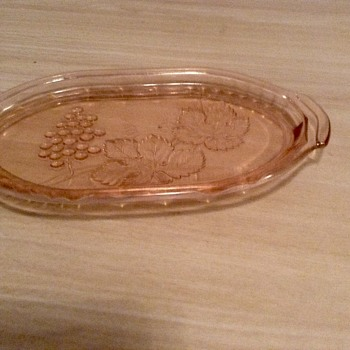 Pink glass tray with grapes and leaf pattern