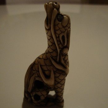 twisted dragon netsuke signed at the bottom
