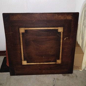 "34"" square table with metal tag on leg ""N.B.D. 13550"""