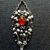 British Arts & Crafts floral silver pendant with carnelian and MoP, c. 1900