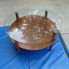midcentury 2 tier coffee table. glass and wood with brass finials