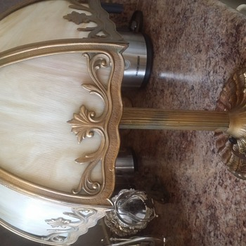 Slag glass brass or bronze lamp . Brought over by my family  from England in the early 1900s