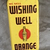wishing well orange sign