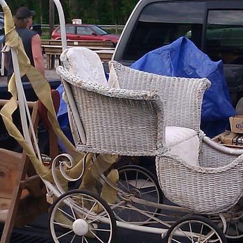 Antique wicker baby stroller.