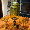 Beverage dispenser with brass spout and glasses
