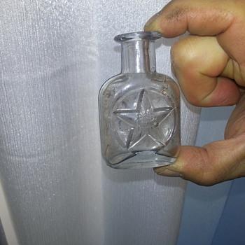 Strange small bottle. - Bottles