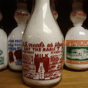 NORMAL SANITARY DAIRY...NORMAL ILLINOIS ...WAR SLOGAN....U.S. NEEDS US STRONG - Bottles