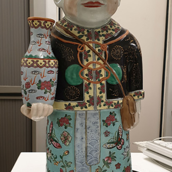 Chinese statue of a man holding a vase - Asian
